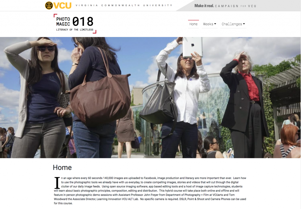 Screenshot of the photography is magic home page. A group of people are looking in many directions. Photo by John Freyer.